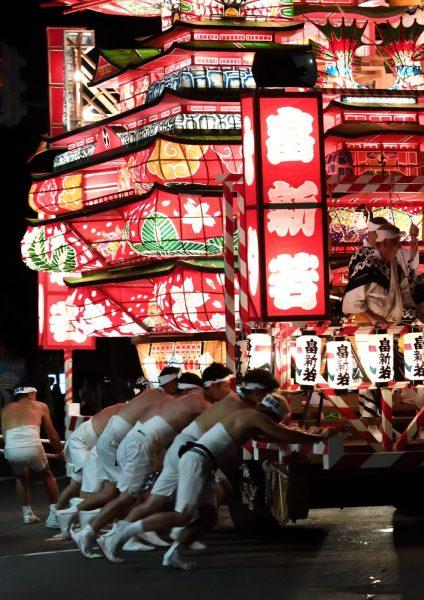 Men pushing a float at the Nebunagashi Festival.