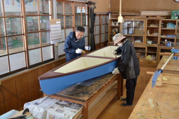 Building a canoe.