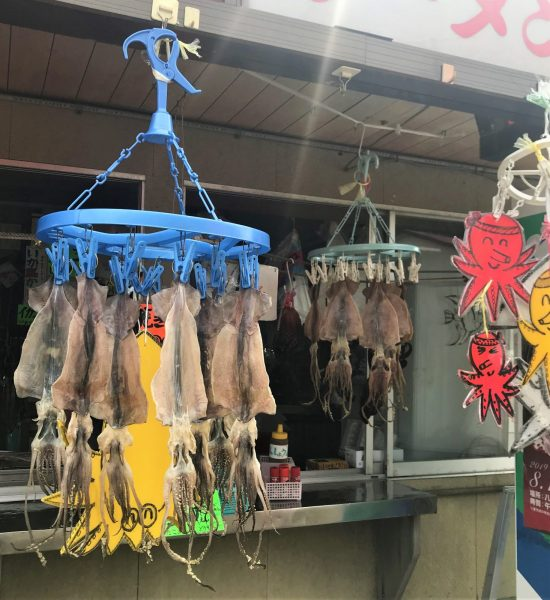Fresh squid hanging outside a local restaurant.
