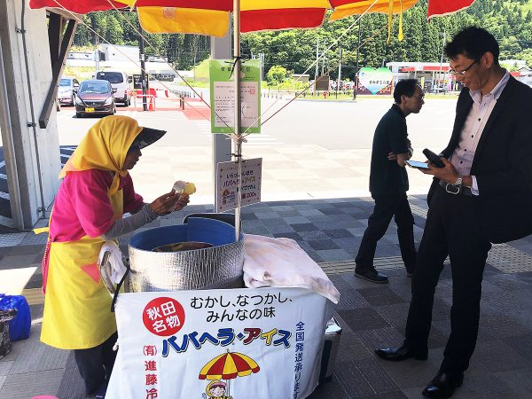 A customer waits for his babahera ice cream.