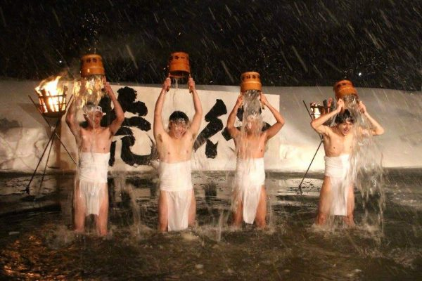 Locals brave the cold in the Fujikoto River.