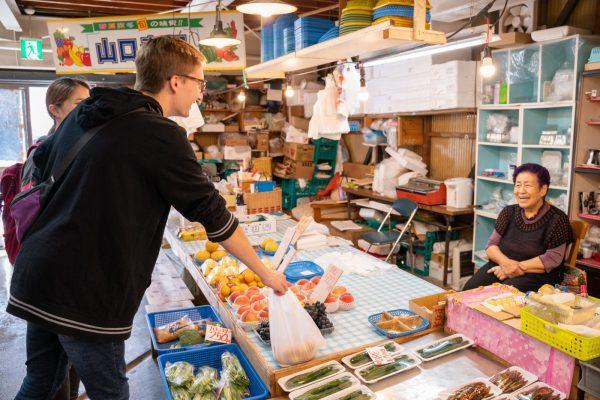 Getting fresh produce at the Hachimori Kankoichi Market.